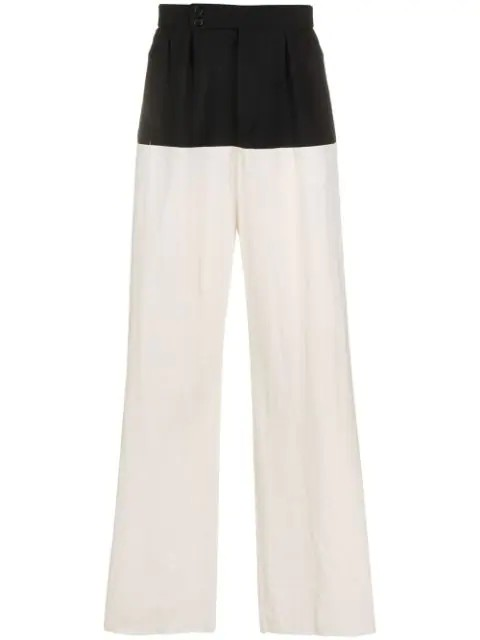 Wide fit pants with horizontal cut and suspenders