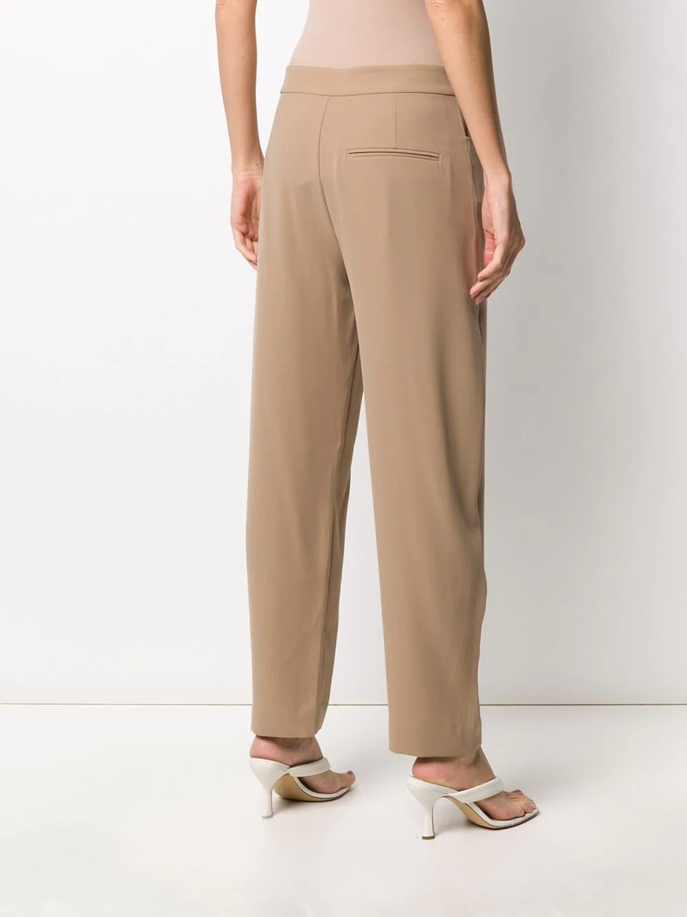 TROUSERS WITH SHAPED LEG